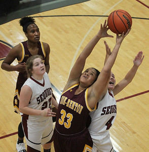 Candace H. Johnson-For Shaw Media Zion-Benton's Jaea Johnson (#33) battles for a rebound with Antioch's Piper Foote (#4) in the third quarter at Antioch Community High School. Zion-Benton won 56-47. (12/17/18)