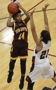 Candace H. Johnson-For Shaw Media Zion-Benton's Jayda Mills leaps up for a shot against Antioch's Noor Abdellatif in the third quarter at Antioch Community High School. Zion-Benton won 56-47. (12/17/18)