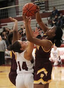 Candace H. Johnson-For Shaw Media Antioch's Rachel Phillips (#14) battles for a rebound with Zion-Benton's Kaylyn Porter and Mary Brewer in the fourth quarter at Antioch Community High School. Zion-Benton won 56-47. (12/17/18)