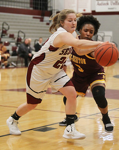 Candace H. Johnson-For Shaw Media Antioch's Nayla Loos battles for control with Zion-Benton's Ranya Jamison in the first quarter at Antioch Community High School. Zion-Benton won 56-47. (12/17/18)