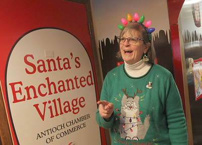 Candace H. Johnson-For Shaw Media Ainsley Wonderling, of Antioch greets visitors at Santa's Enchanted Village on Main Street in downtown Antioch. (12/15/18)