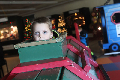 Candace H. Johnson-For Shaw Media Weston Miller, 3, of Antioch plays in a large wooden train at the Kringle's Christmas Village indoor showroom located in Orchard Plaza in downtown Antioch. Kringle's Christmas Village is open 10 a.m.- 8 p.m. daily through Christmas Day.(12/15/18)
