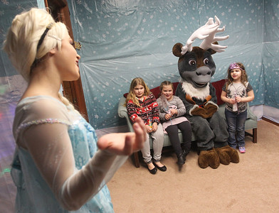 "Candace H. Johnson-For Shaw Media Queen Elsa sings, ""Let It Go,"" with Lily Lorenzen, 11, of Antioch and her sisters, Ashlyn and Violet, both 6, as they sit with Sven at Santa's Enchanted Village on Main Street in downtown Antioch.Queen Elsa (Jessica Lamberty, 19, of Antioch) and Sven (Madison Novack, 17, of Lake Villa) are characters from the movie, ""Frozen."" (12/15/18)"