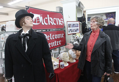 Candace H. Johnson-For Shaw Media Betty Sills, of Antioch looks at one of the Dickens characters from Dickens Holiday Village featured at the Dickens Welcome Center in Hannah's during Antioch's holiday events in downtown Antioch. Dickens characters are placed on the sidewalks of Main Street and Lake Street. (12/15/18)