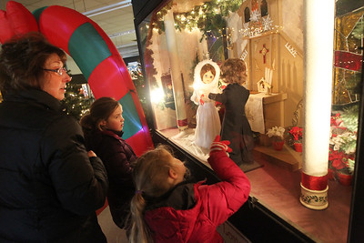 "Candace H. Johnson-For Shaw Media Denise Zuhlke, of Antioch and her granddaughters, Frankie Smith, 6, of Oak Park and her sister, Evie, 4, look at a large shadow box called, ""Kringle's True Love Wedding Chapel,"" at the Kringle's Christmas Village indoor showroom located in Orchard Plaza in downtown Antioch. Kringle's Christmas Village is open 10 a.m.- 8 p.m. daily through Christmas Day.(12/15/18)"