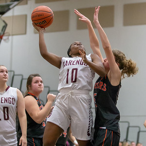 Marengo's Jordan Parker drives the lane for the basket against Crystal Lake Central's Nora Ryan Friday, December 21, 2018 at the Northern Illinois Girls Holiday Classic basketball tournament in McHenry. Marengo gets the win, 53-36. KKoontz – For Shaw Media