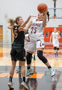 Marengo's Marissa Knobloch drives the lane and gets the basket against Crystal Lake Central's Nora Ryan Friday, December 21, 2018 at the Northern Illinois Girls Holiday Classic basketball tournament in McHenry. Knobloch scored 27 points in the game giving Marengo the win, 53-36. She has scored 108 total points in four tournament games.  KKoontz – For Shaw Media
