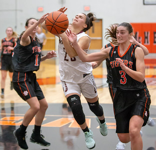 Marengo's Marissa Knobloch drives the lane and draws the foul by Crystal Lake Central's Corrine Hamill Friday, December 21, 2018 at the Northern Illinois Girls Holiday Classic basketball tournament in McHenry. Knobloch scored 27 points in the game giving Marengo the win, 53-36. She has scored 108 total points in four tournament games.  KKoontz – For Shaw Media