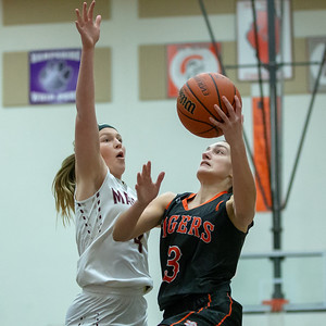 Crystal Lake Central's Corrine Hamill goes up for a shot against Marengo's Hannah Ritter Friday, December 21, 2018 at the Northern Illinois Girls Holiday Classic basketball tournament in McHenry. Marengo gets the win, 53-36. KKoontz – For Shaw Media
