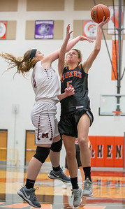 Crystal Lake Central's Nora Ryan goes up for a shot against Marengo's Hannah Ritter Friday, December 21, 2018 at the Northern Illinois Girls Holiday Classic basketball tournament in McHenry. Marengo gets the win, 53-36. KKoontz – For Shaw Media