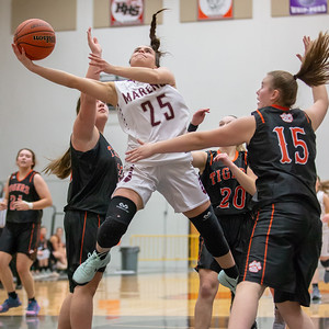 Marengo's Marissa Knobloch drives the lane and gets the basket against Crystal Lake Central Friday, December 21, 2018 at the Northern Illinois Girls Holiday Classic basketball tournament in McHenry. Knobloch scored 27 points in the game giving Marengo the win, 53-36. She has scored 108 total points in four tournament games.  KKoontz – For Shaw Media