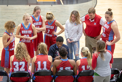 Marian Central Catholic high school graduate (Class of 2014) and now head basketball coach Ephraim Lee talks with his team Friday, December 21, 2018 at the Northern Illinois Girls Holiday Classic basketball tournament in McHenry. Marian pulled away in the fourth quarter to take the win 46-36 and will play Marengo tomorrow in the championship game.  KKoontz – For Shaw Media