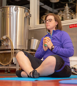 Amanda Storer from McHenry practices breathing exercises at Yoga and Beer with Akasha held Wednesday, December 26, 2018 at the Crystal Lake Brewery in Crystal Lake. KKoontz – For Shaw Media