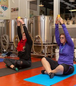 Meredith Pazkalski from Johnsburg (Left) and Amanda Storer from McHenry (Right) attend the Yoga and Beer with Akasha held Wednesday, December 26, 2018 at the Crystal Lake Brewery in Crystal Lake. KKoontz – For Shaw Media