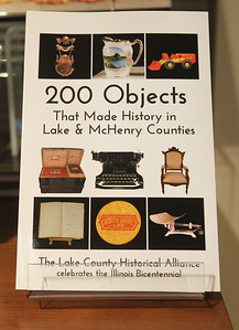 """Candace H. Johnson-For Shaw Media Stories from the book, """"200 Objects That Made History in Lake and McHenry Counties,""""  were featured during the Illinois Bicentennial Celebration at the Bess Bower Dunn Museum in Libertyville. Free programs are offered at the Dunn Museum every 1st and 3rd Thursday evening. A copy of the book can be bought at the museum's gift shop.(12/20/18)"""