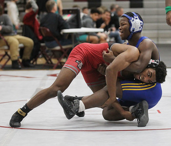 Candace H. Johnson-For Shaw Media Antioch's Jackie Sistrunk, 17, battles to take down Simeon's Jakody Keys, 15, in the second round of the 152 lb. weight class during the Holiday Duals wrestling quad at Antioch Community High School. Antioch's Sistrunk won 28-13. (12/22/18)