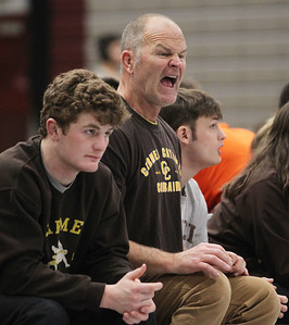 Candace H. Johnson-For Shaw Media Carmel's Tom Hoy, of Wauconda, assistant coach, (center) watches one of his varsity wrestlers compete during the Holiday Duals wrestling quad at Antioch Community High School. Other schools who competed in the quad included Waukegan, Antioch, Woodstock North, Simeon and McHenry. (12/22/18)