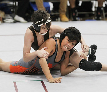 Candace H. Johnson-For Shaw Media Carmel's Evan Garcia, of Round Lake Heights battles for control with McHenry's Cruz Basulto, of McHenry, both 14, in the second round of the 106 lb. weight class during the Holiday Duals wrestling quad at Antioch Community High School. McHenry's Basulto won by a pin.(12/22/18)