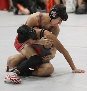 Candace H. Johnson-For Shaw Media Antioch's Alex Barbarise, 16, tries to bring down McHenry's Aldair Perea, 15, as they compete in the third round of the 120 lb. weight class during the Holiday Duals wrestling quad at Antioch Community High School.Antioch's Barbarise won by a pin.  (12/22/18)