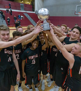 The Crystal Lake Central Tigers celebrate after winning the E.C. Nichols Tournament championship, defeating Hampshire 75-58 Saturday, December 29, 2018 in Marengo. KKoontz – For Shaw Media