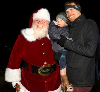 Candace H. Johnson-For Shaw Media Santa takes a photo with David Fischer, of Gurnee and his son, Gabe, 2, before the Canadian Pacific Holiday Train makes a stop near Viking Park in Gurnee. (12/2/19)