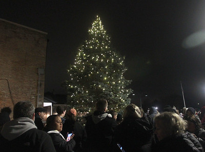 Candace H. Johnson-For Shaw Media Visitors gather around the holiday tree for the tree lighting during the Grayslake Tree Lighting Festivities in downtown Grayslake. (11/29/19)