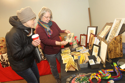 Candace H. Johnson-For Shaw Media Diane Nachenberg talks with Ena Potter, both of Grayslake, with Eco Printing about the original prints and cards she had for sale in the Holiday Market at the Grayslake Heritage Center & Museum during the Grayslake Tree Lighting Festivities in downtown Grayslake. (11/29/19)