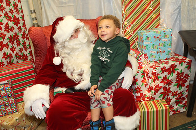 Candace H. Johnson-For Shaw Media Carter Cadman, 5, of Grayslake tells Santa about what he wants for Christmas at The Oasis during the Grayslake Tree Lighting Festivities in downtown Grayslake. (11/29/19)