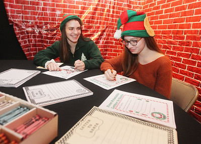 Candace H. Johnson-For Shaw Media Ainsley Hanner, 18, of Gurnee and her sister, Elinor, 14, write letters to Santa at The Oasis during the Grayslake Tree Lighting Festivities in downtown Grayslake. (11/29/19)