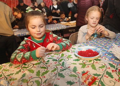 Candace H. Johnson-For Shaw Media Emma Schaefer, 6, of Grayslake and Maddie Fox, 7, of Round Lake make a candy cane ornament craft at The Oasis during the Grayslake Tree Lighting Festivities in downtown Grayslake. (11/29/19)