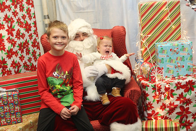 Candace H. Johnson-For Shaw Media Maddux Schlesinger, 8, of Lindenhurst and his sister, Harper, 1, get their picture taken with Santa at The Oasis during the Grayslake Tree Lighting Festivities in downtown Grayslake. (11/29/19)