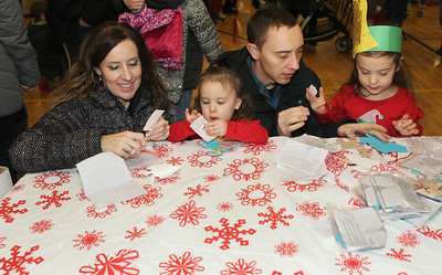 Candace H. Johnson-For Shaw Media Tonia Sewell, of Lake Villa helps her son, David, and his children, Ava, 2, and Arya, 4, make a llama ornament craft during the Holiday Tree Lighting at the Lippert Community Center in Lindenhurst. (12/7/19)