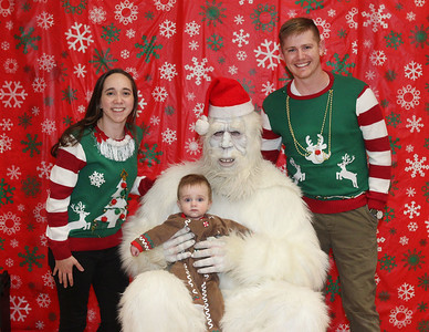 Candace H. Johnson-For Shaw Media Sarah and Glen Pringle, of Lake Villa and their son, James, nine-months-old, get their photo taken with the Yeti, (an Abominable Snowman), during the Holiday Tree Lighting at the Lippert Community Center in Lindenhurst. (12/7/19)