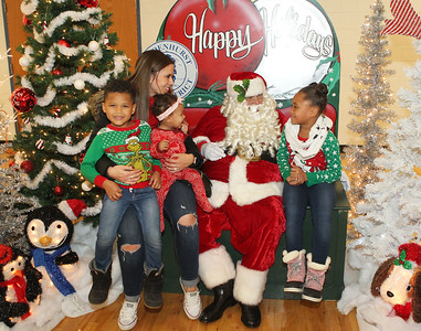 Candace H. Johnson-For Shaw Media Ashley Poyser, of Lake Villa and her children, Camden, 4, Londyn, nine-months-old, and Aubrianna, 7, visit with Santa during the Holiday Tree Lighting at the Lippert Community Center in Lindenhurst. (12/7/19)