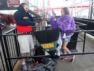 Candace H. Johnson-For Shaw Media Brad Martin, of Ottawa and his daughter, Kelsie, 16, put warm clothes on over t-shirts and shorts as they take a break from riding the X-Flight several times during the Polar Coaster Challenge at Six Flags Great America. The event was held to celebrate the start of the winter season. Volunteer riders donated cold weather survival items to benefit PADS before riding the X-Flight in t-shirts, tank tops and shorts. (12/7/19)
