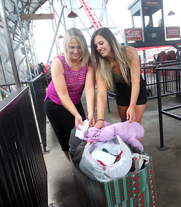 Candace H. Johnson-For Shaw Media Kathy Jordan, of St. Charles and her daughter, Jennifer, donate cold weather items to benefit PADS before riding the X-Flight in tank tops and shorts during the Polar Coaster Challenge at Six Flags Great America in Gurnee. The event was held to celebrate the start of the winter season. Volunteer riders donated cold weather survival items to benefit PADS before riding the X-Flight in t-shirts, tank tops and shorts. The Jordans rode the X-Flight nine times straight. (12/7/19)