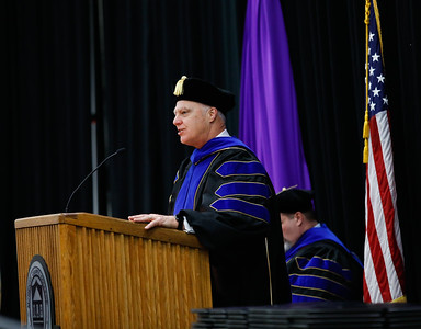 Dr. Clinton Gabbard, president of McHenry County College, speaks at the winter commencement on Saturday in Crystal Lake. Photo by Bev Horne