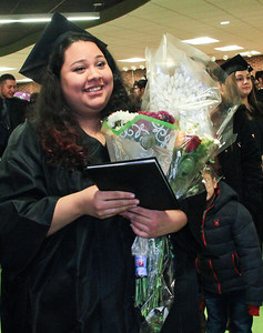 Patricia Quiroz is all smiles after graduation at McHenry County College on Saturday in Crystal Lake. Photo by Bev Horne