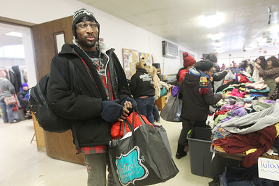 Candace H. Johnson-For Shaw Media Darron Martin, of Antioch heads out after getting three bags of donated items during the Antioch Traveling Closet Winter Giveaway event at the Antioch Senior Center in Antioch.  (12/14/19)