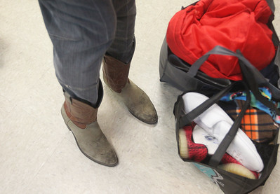 Candace H. Johnson-For Shaw Media Darron Martin, of Antioch shows off the new cowboy boots he found and was wearing during the Antioch Traveling Closet Winter Giveaway event at the Antioch Senior Center in Antioch.  (12/15/19)