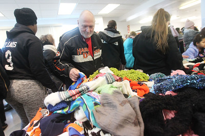 Candace H. Johnson-For Shaw Media Wild Bill Urban, of Fox Lake looks for a scarf during the Antioch Traveling Closet Winter Giveaway event at the Antioch Senior Center in Antioch.  (12/14/19)