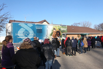 Candace H. Johnson-For Shaw Media People line up outside of the Antioch Senior Center before the doors open for the Antioch Traveling Closet Winter Giveaway event in Antioch.  (12/15/19)