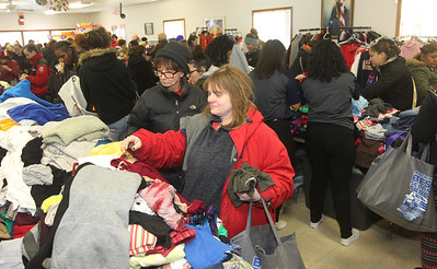 Candace H. Johnson-For Shaw Media Kimberly Johnson, (center) of Round Lake Beach looks for some clothes during the Antioch Traveling Closet Winter Giveaway event at the Antioch Senior Center in Antioch.  (12/14/19)