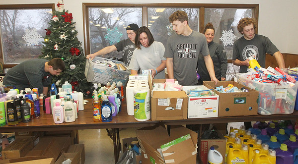 Candace H. Johnson-For Shaw Media Co-founders Lisa Fisher and Heather Lewis, both of Antioch work with Jacob Moisa, Andrew Bowles, Evan Day, all 16, of Antioch and Caleb Crombaugh, 17, of Lake Villa putting toiletries on tables the day before the Antioch Traveling Closet Winter Giveaway event at the Antioch Senior Center in Antioch.  (12/14/19)