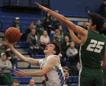 Candace H. Johnson-For Shaw Media Lakes Jake Sanders aims for the hoop against Grayslake Central's Grant Hardy in the second quarter at Lakes Community High School in Lake Villa. Lakes won 36-30. (12/14/19)