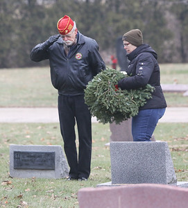 Candace H. Johnson-For Shaw Media Richard Butler, of Winthrop Harbor, a Marine Corps veteran and Carol Mampe, of Grayslake, an associate member of the Marine Corps League of Lake County Detachment 801, lay a wreath at a veteran's grave during Wreaths Across America at the Warren Funeral Home Cemetary in Gurnee.  (12/14/19)
