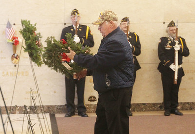 Candace H. Johnson-For Shaw Media Marine Corps veteran Gerald Pedrin, of Beach Park laid the wreath to honor the U.S. Marines Corps during the Wreaths Across America ceremony at the Warren Funeral Home Mausoleum in Gurnee. Pedrin served two tours of Vietnam and has received five Purple Hearts.  (12/14/19)