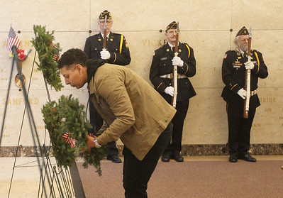 Candace H. Johnson-For Shaw Media Jennifer Booth, on active duty at Great Lakes for the Army, laid a wreath to honor the U.S. Air Force during the Wreaths Across America ceremony at the Warren Funeral Home Mausoleum in Gurnee.  (12/14/19)