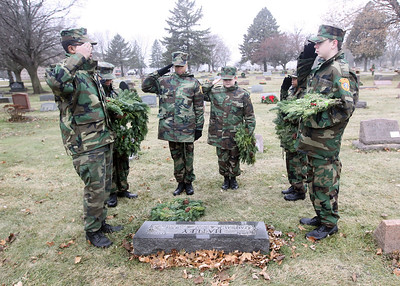 Candace H. Johnson-For Shaw Media The Lake County Young Marines laid a wreath at the Hatley grave to honor military veteran Jesse Hatley during Wreaths Across America at the Warren Funeral Home Cemetary in Gurnee.  (12/14/19)