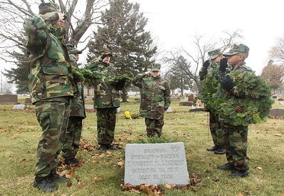 Candace H. Johnson-For Shaw Media Ryan Siedlecki, 10, of Antioch (center) and the Lake County Young Marines laid a wreath at the gravesite of Kenneth R. Liebert, a Vietnam veteran who served in the Army, during Wreaths Across America at the Warren Funeral Home Cemetary in Gurnee. Ryan is the nephew of Kenneth Liebert who was laid to rest. (12/14/19)